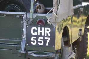 Signwriting by Arne Barker Period hand painted number plates on rear of Land Rover Series One