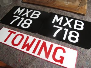 Sign written number plates and Towing sign