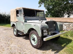 Early Land-Rover with plenty of patina and hand painted plates